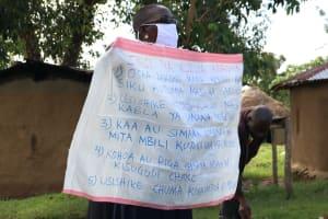 The Water Project: Mukhuyu Community, Kwakhalakayi Spring -  The Facilitator Holding Up The Chart