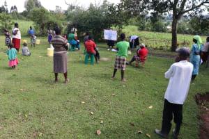 The Water Project: Mukhuyu Community, Kwakhalakayi Spring -  The Facilitator Using The Chart To Teach