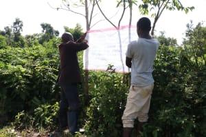 The Water Project: Mukhuyu Community, Kwakhalakayi Spring -  Two Community Members Mounting The Chart