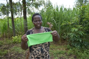 The Water Project: Burachu B Community, Namukhuvichi Spring -  A Community Member Following Closely On How To Make A Mask