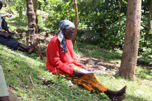 The Water Project: Imbinga Community, Arunga Spring -  An Elderly Woman In Attendance Of Covid Sensitization