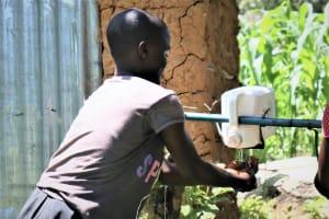 The Water Project: Imbinga Community, Arunga Spring -  Using A Leaky Tin