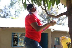 The Water Project: Kambiri Community, Sachita Spring -  Demonstrating Handwashing