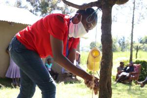 The Water Project: Kambiri Community, Sachita Spring -  Handwashing Using An Installed Leaky Tin