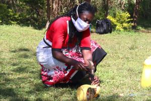 The Water Project: Kambiri Community, Sachita Spring -  Using Local Materials To Make A Handwashing Station