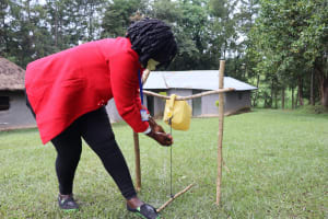 The Water Project: Bung'onye Community, Shilangu Spring -  Using A Hands Free Handwashing Station
