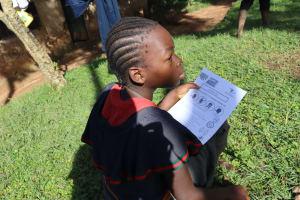 The Water Project: Mubinga Community, Mulutondo Spring -  A Child Following The Training