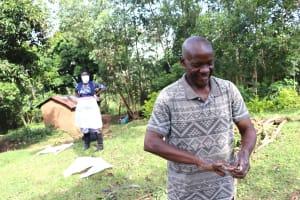 The Water Project: Mubinga Community, Mulutondo Spring -  Community Elder Leading Handwashing Training