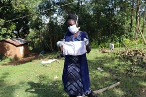 The Water Project: Mubinga Community, Mulutondo Spring -  Demonstration On Making A Homemade Mask