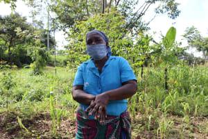 The Water Project: Mubinga Community, Mulutondo Spring -  Handwashing Demonstration