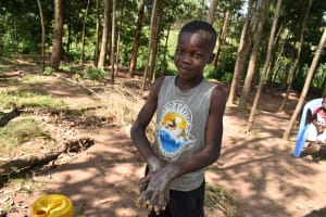 The Water Project: Maondo Community, Ambundo Spring -  A Young Boy Excited To Wash His Hands