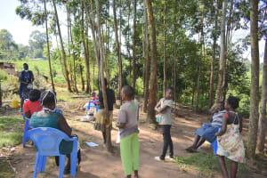 The Water Project: Maondo Community, Ambundo Spring -  Community Members Listening In To Ms Shigali