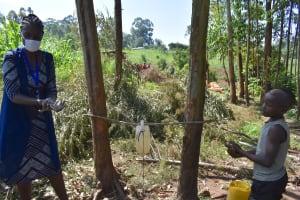 The Water Project: Maondo Community, Ambundo Spring -  The Facilitator Leading A Handwashing Demonstration
