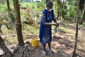 The Water Project: Maondo Community, Ambundo Spring -  The Facilitator Showing The Community Members How To Make A Simple Mask