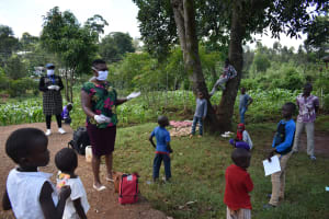 The Water Project: Lutonyi Community, Lutomia Spring -  Facilitator Protected With Ppe