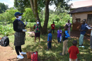 The Water Project: Lutonyi Community, Lutomia Spring -  Ms Kayi Leading The Training Session