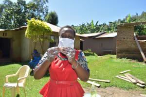 The Water Project: Imbinga Community, Imbinga Spring -  Facilitator Karen Demonstrates Handwashing