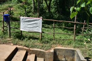 The Water Project: Imbinga Community, Imbinga Spring -  Installed Reminder Chart At The Spring