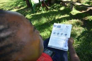 The Water Project: Imbinga Community, Imbinga Spring -  Leaflets With Covid Information Used At The Training