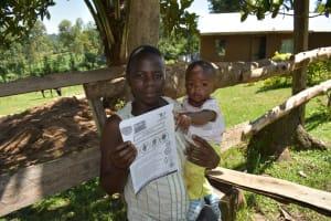 The Water Project: Imbinga Community, Imbinga Spring -  Using Handouts At The Training