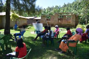 The Water Project: Imbinga Community, Imbinga Spring -  Using Reminder Chart At Training