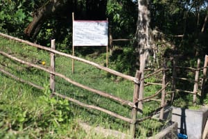 The Water Project: Buyangu Community, Mukhola Spring -  Installed Reminder Chart At Mukhola Spring
