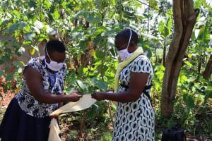 The Water Project: Shisere Community, Richard Okanga Spring -  Facilitators Help Make Masks For Participants