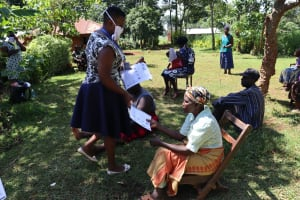 The Water Project: Shisere Community, Richard Okanga Spring -  Issuing Handouts With Covid Information