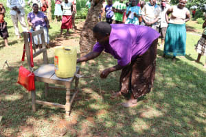 The Water Project: Shisere Community, Richard Okanga Spring -  Using A Locally Made Leaky Tin Handwashing Stations