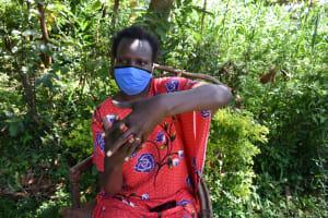 The Water Project: Ebutindi Community, Tondolo Spring -  A Health Worker Demonstrating Proper Steps Of Handwashing