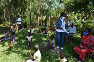 The Water Project: Ebutindi Community, Tondolo Spring -  Issuing Handouts To Participants