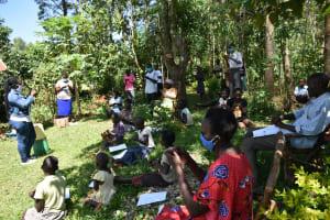 The Water Project: Ebutindi Community, Tondolo Spring -  Participants Following The Ten Steps Of Handwashing