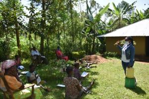 The Water Project: Ebutindi Community, Tondolo Spring -  Training On How To Make A Handwashing Station
