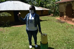 The Water Project: Ebutindi Community, Tondolo Spring -  Using Readily Found Jerrycans To Make Handwashing Stations