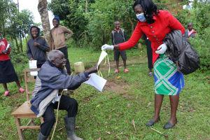 The Water Project: Buyangu Community, Osundwa Spring -  Distributing Masks To Participants