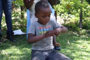 The Water Project: Mukangu Community, Metah Spring -  A Child Washing Hands At The Training