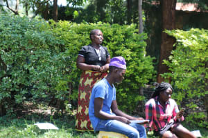 The Water Project: Mukangu Community, Metah Spring -  A Community Member Reacting To The Training