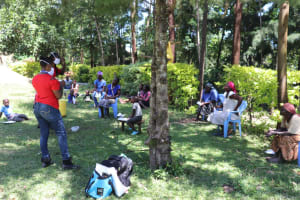 The Water Project: Mukangu Community, Metah Spring -  Conducting Training Under A Tree