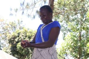 The Water Project: Mukangu Community, Metah Spring -  Handwashing Demonstration