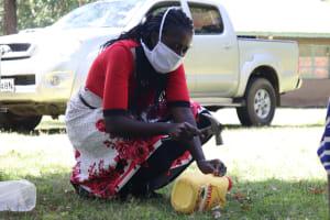 The Water Project: Mukangu Community, Metah Spring -  Illustration On Making Leaky Tins