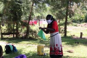 The Water Project: Mukangu Community, Metah Spring -  Making Homemade Masks