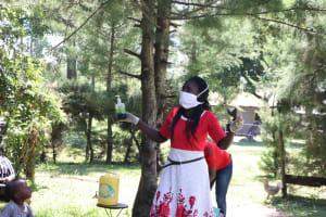 The Water Project: Mukangu Community, Metah Spring -  Ms Shigali Conducting Covid Sensitization