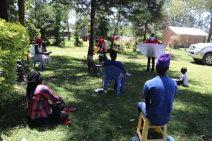 The Water Project: Mukangu Community, Metah Spring -  Reviewing Prevention Reminders Chart