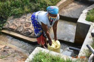 The Water Project: Sichinji Community, Kubai Spring -  Margaret Mbone Fetching Water
