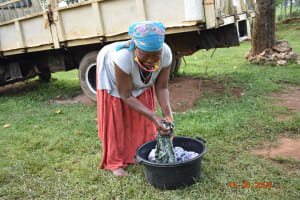 The Water Project: Sichinji Community, Kubai Spring -  Margaret Mbone Doing Her Laundry With Water From Kubai Spring