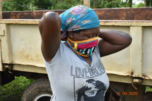 The Water Project: Sichinji Community, Kubai Spring -  Margaret Mbone Wearing Her Mask