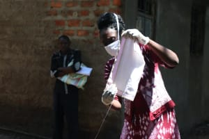 The Water Project: Mwinaya Community, Severe Spring -  Demonstration On Making Homemade Masks