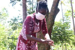 The Water Project: Mwinaya Community, Severe Spring -  Handwashing Demonstration