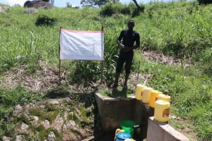 The Water Project: Mwinaya Community, Severe Spring -  Installed Reminder Chart At Spring Site