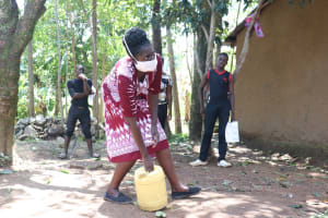 The Water Project: Mwinaya Community, Severe Spring -  Using Locally Available Materials In Making Handwashing Points